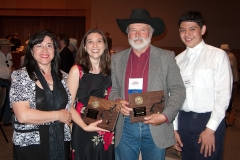 John with Leah Hultonschmidt, editor at Dorchester Publishing, along with his wife, Rocio, and son, Dimitri, at the WWA convention in Oklahoma City in 2009.