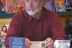 John at a book signing at City News in Cheyenne in 2003.