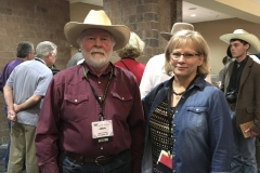 "John with Micki Fuhrman Milom, co-writer of ""Rangeland Lament,"" at the WWA convention in Billings in 2018."